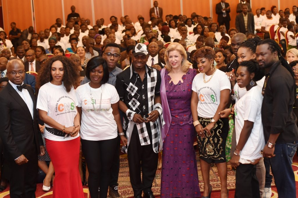 First Lady Dominique Ouattara in the company of the group of artists against child labor