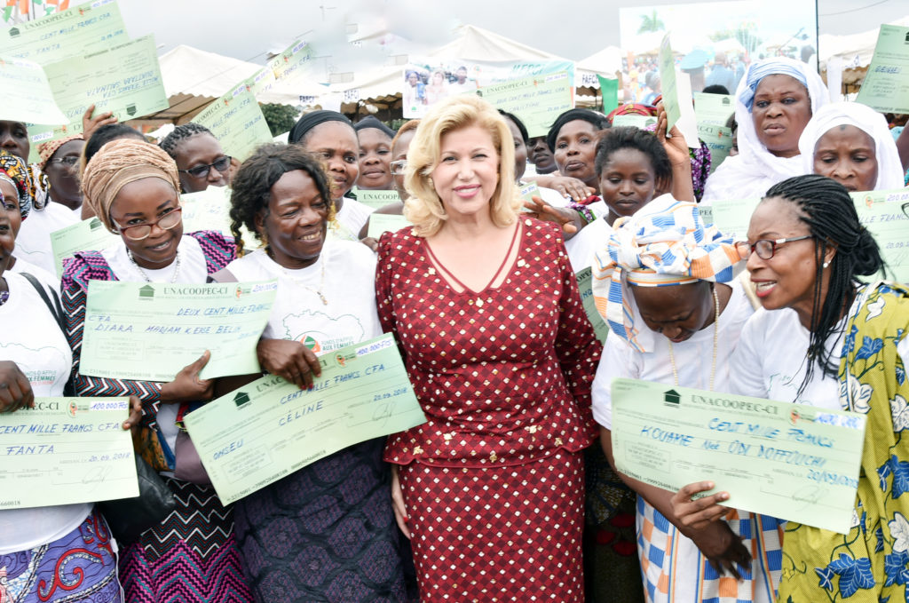 The First Lady gives checks and make donations to women in Abidjan
